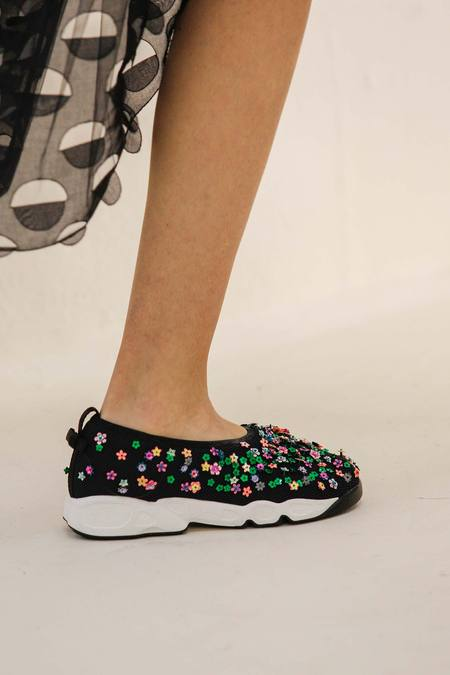These bejeweled sneakers made their debut at Dior's spring 2014 couture show. Photo: Style